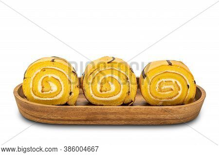 Row Of Sliced Cake Roll In A Wooden Tray On White Background With Clipping Path.