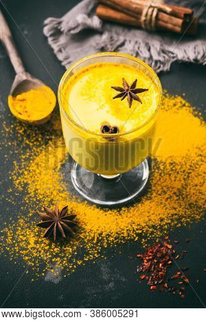 Golden Milk. Traditional Indian Drink With Turmeric, Cinnamon, Star Anise. Selective Focus