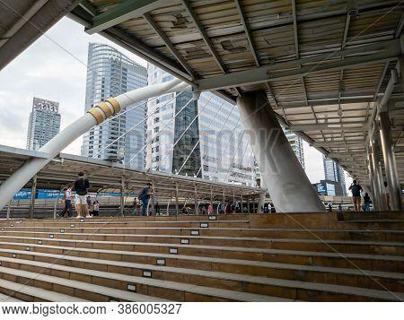 Chong Nonsi, Bangkok-15 September 2020: Office Workers Leaving Work Walking Through The Skywalk To T