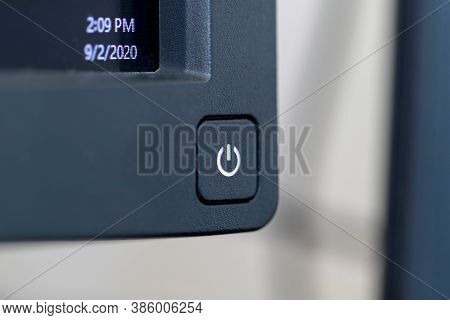 A Portrait Of The On Or Off Button At The Corner Of A Pc Monitor Ready To Be Pressed. The Computer S