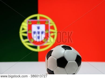 Small Football On The White Floor And Portuguese Nation Flag Background. The Concept Of Sport, Portu