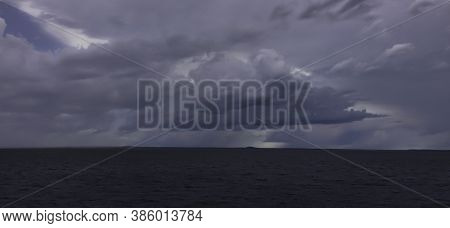 Storm Clouds Gathering At Dusk, Off The Shore Of Darwin, Australia