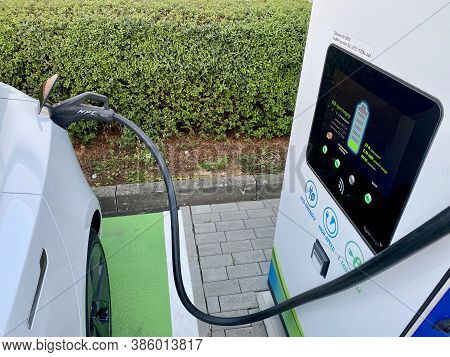 Ostfildern, Germany - August 27, 2020: Modern Electric Car Recharged At Electrical Charging Station