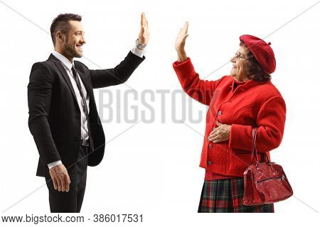 Man in a suit gesturing high-five with an elderly lady isolated on white background