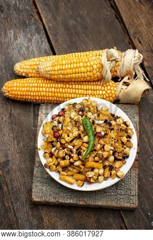 Closeup Of Spicy Corn Kernel Or Maize Seeds In A Plate With Dry Maize In Vertical Orientation