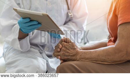 Elderly Senior Adult Patient (older Person) Having Geriatric Doctor Consulting And Diagnostic Examin