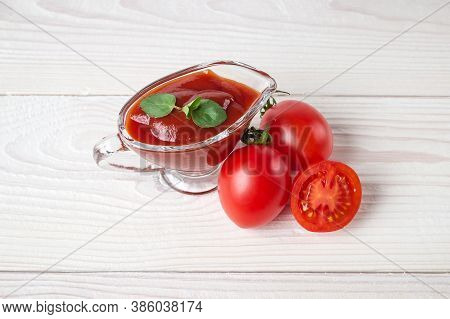 Cherry Tomatoes, Spices And A Glass Sauceboat With Ketchup On A White Background. Seasonings, Tomato