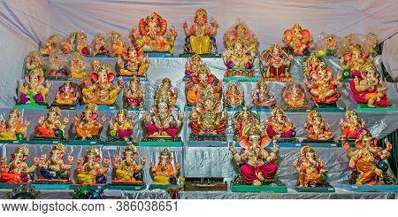 Colorful Clay Made Idols Of Hindu God Lord Ganesha Ready For Sale At A Stall In Pune, Maharashtra, I