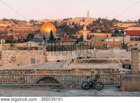 View Of Old Jerusalem From The Mount. View Of Old City From The Roof, With Lattice And Bicycle On Fo