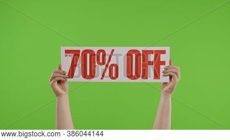 70 Percent Off Advertisement Inscription On Paper Sheet In Womans Hands On Green Screen. Holiday Dis