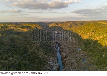 Pulo Do Lobo Waterfall Drone Aerial View With River Guadiana And Beautiful Green Valley Landscape At