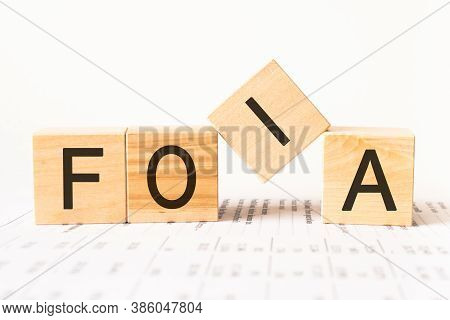 Word Foia. Wooden Small Cubes With Letters Isolated On White Background With Copy Space Available.bu