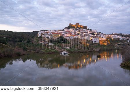 Mertola City View At Sunset With Guadiana River In Alentejo, Portugal