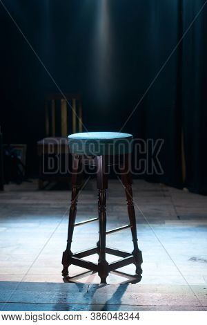 Wooden High Bar Stool On A Wooden Stage