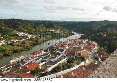 Mertola City View White Historic Beautiful Traditional Village In Alentejo, Portugal With River Guad