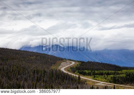 Scenic Route, Alaska Hwy, During A Sunny And Cloudy Day. West Of Whitehorse, Yukon, Canada.