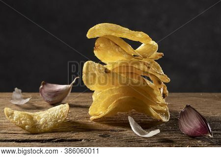 A Pile Of Crispy Potato Chips Prepared With Fresh Garlic.