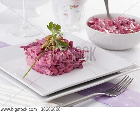 Beetroot Salad Served With Walnuts And Parsley.