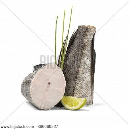 Hake Slice And Tail Isolated On White With Lime And Chive.