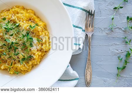 Autumn Pumpkin Risotto With Marjoram, Close Up. Tasty Vegetarian Dish, Close Up.