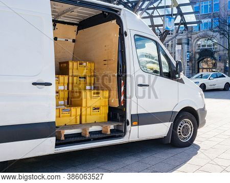 Hamburg, Germany - 20 Mar 2020: White Mercedes-benz Sprinter Parcel Delivery Van With Yellow Boxes W
