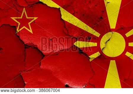 Historical Flag Of Socialist Republic Of Macedonia And Today North Macedonia Flag Painted On Cracked