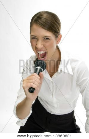 Businesswoman Singing Into Mike
