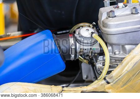 Close Up Carburetor Assembly With Body And Cylinder Head Engine Of Mini Racing Car Sport Go Kart