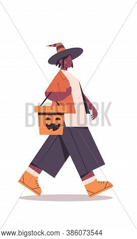 Cute Girl Holding Bucket With Pumpkin African American Woman In Fairy Costume Happy Halloween Party