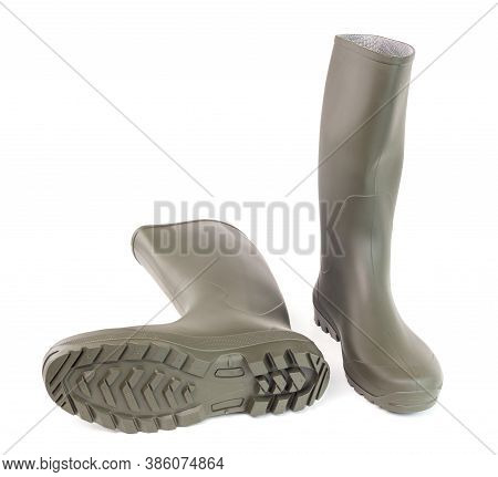 A Pair Of Clean Green Rubber Boots Isolated On White Background. Front View.