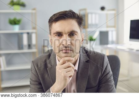 Business Man Looking At Camera During Videocall In Office