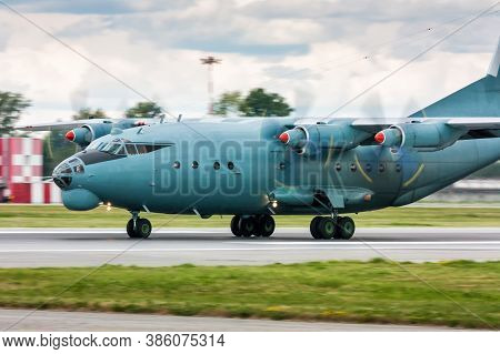Four Engine Turboprop Cargo Aircraft Heading On The Runway