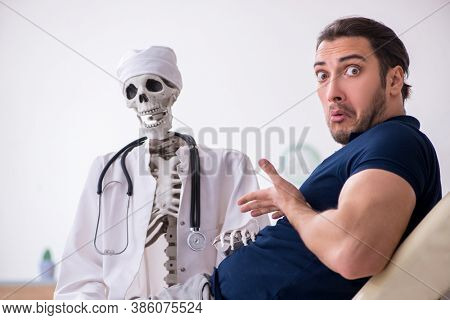 Young man visiting dead doctor