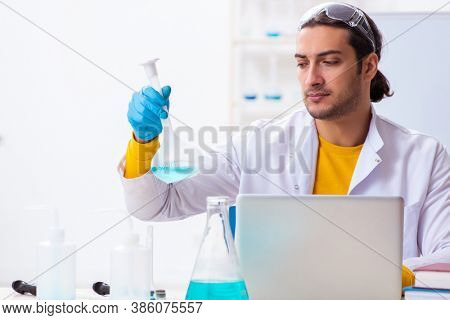 Young male chemist student preparing for exam