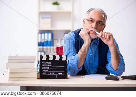 Old male author writing screenplay