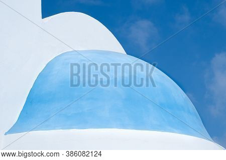 Details Of A White And Blue Christian Church Dome Against Blue Cloudy Sky. Abstract Architecure Phot