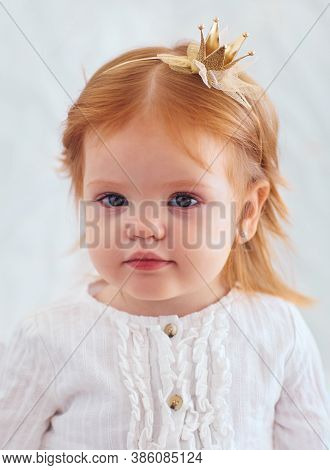 Shoulder Portrait Of A Cute Nineteen Month Old Baby Girl