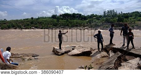 City Jabalpur, India - August 18, 2019: Indian People Clicking Picture At Narmada River In Bhedaghat