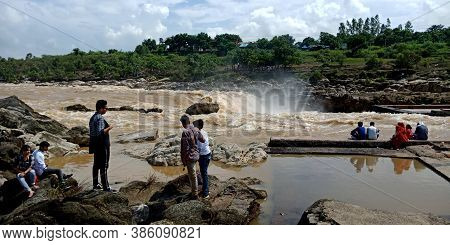 City Jabalpur, India - August 18, 2019: Indian People Standing A Risk At Narmada River In Bhedaghat