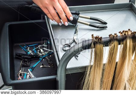 Hair Extension Master's Workplace. The Process Of Building Strands In A Beauty Salon