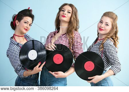 Women In The Style Of Fifties With Vinyl Records.