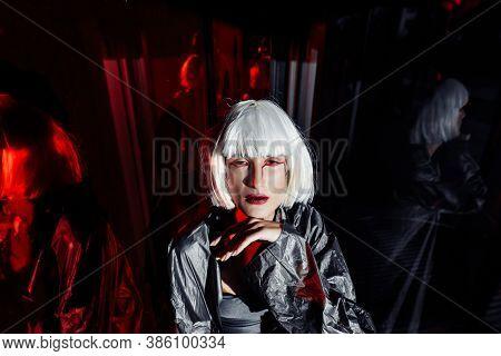 Fashion Of The Future. Futuristic Blonde In Black Space.