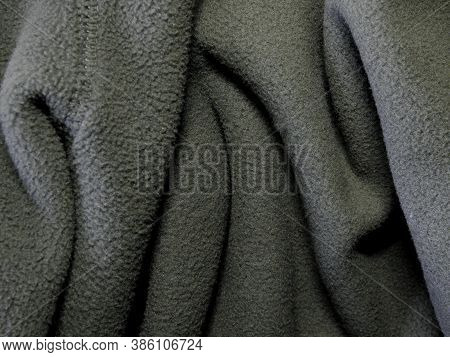 Blanket Made Of Fluffy Fleece Fabric. Background Made Of Soft Plush Fleece Material With Lots Of Rai