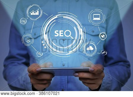 Seo-optimization Concept. Unrecognizable Woman Browsing Internet On Phone Searching Information Onli