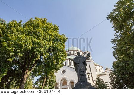Saint Sava Cathedral Temple (hram Svetog Save) In The Afternoon And The Statue Dedicated To Sveti Sa