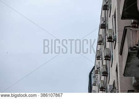 Air Conditioning Units, Or Ac, On Display With Their Fans On A Decaying Facade Of An Old Building Of