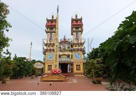 Hoi An, Vietnam, September 20, 2020: Main Facade With A Monolith In The Courtyard Of The Cao Dai Tao