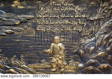 Hoi An, Vietnam, September 20, 2020: Bronze Relief Of A Monk In The Garden Of Tinh Xá Ngoc Cam Templ
