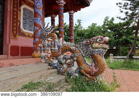 Hoi An, Vietnam, September 20, 2020: Colorful Dragon On The Access Stairs Of The Van Mieu Confucius