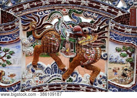 Hoi An, Vietnam, September 20, 2020: Dragon On The Colorful Decorated Wall In The Courtyard Of The V